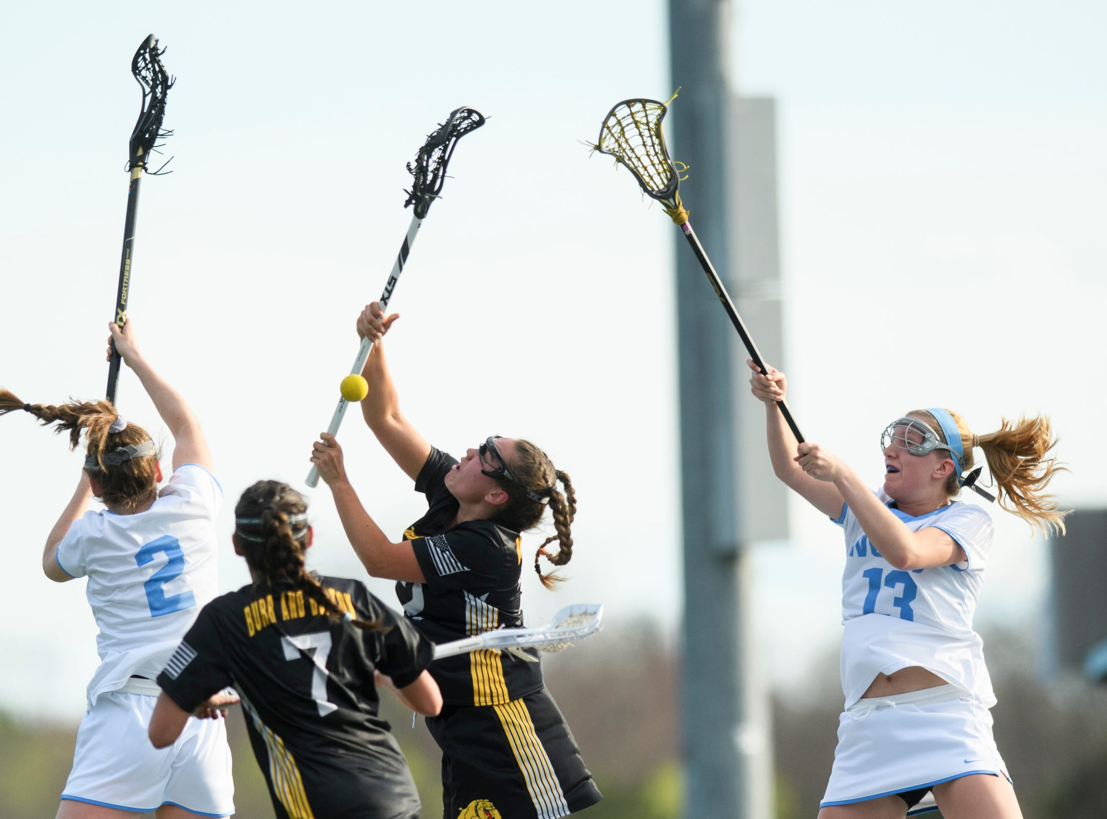 Burr and Burton's Fiona McMahon (2) battles for the loose ball with South Burlington's Kate hall (2) during the high school girls lacrosse game between Burr and Burton Bulldogs and the South Burlington Wolves at Munson Field on Monday afternoon May 6, 2019 in South Burlington, Vermont.