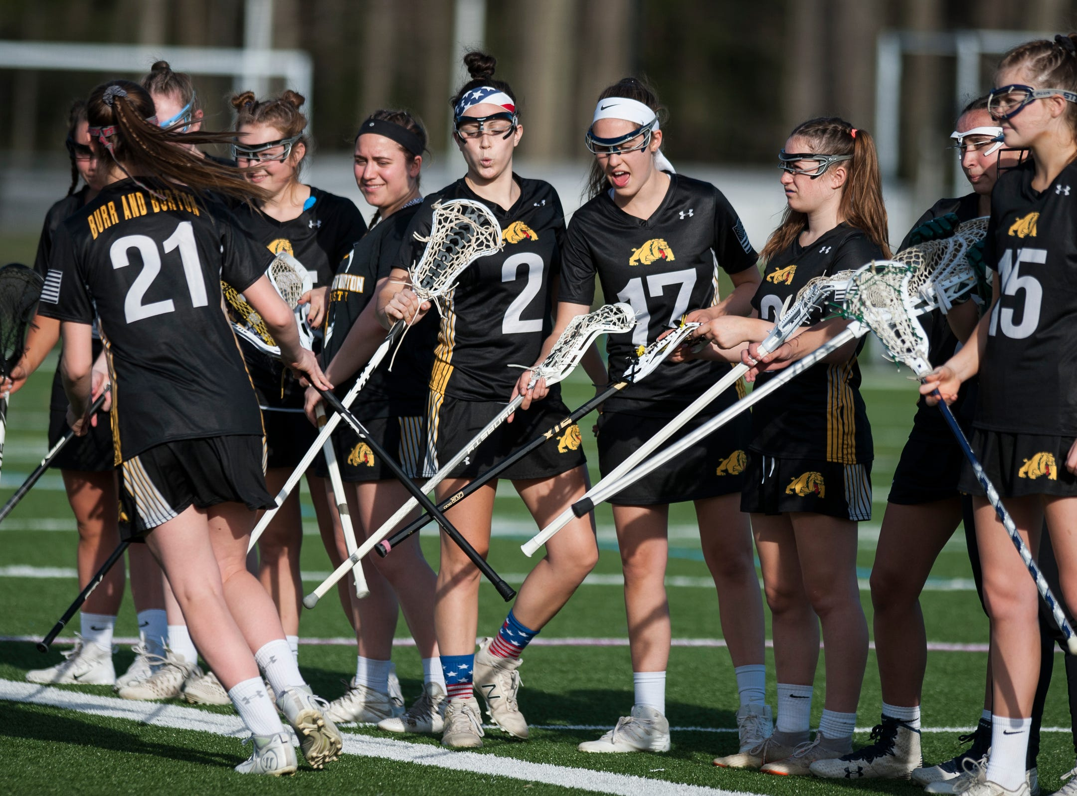 Burr and Burton girls high five each other during the high school girls lacrosse game between Burr and Burton Bulldogs and the South Burlington Wolves at Munson Field on Monday afternoon May 6, 2019 in South Burlington, Vermont.