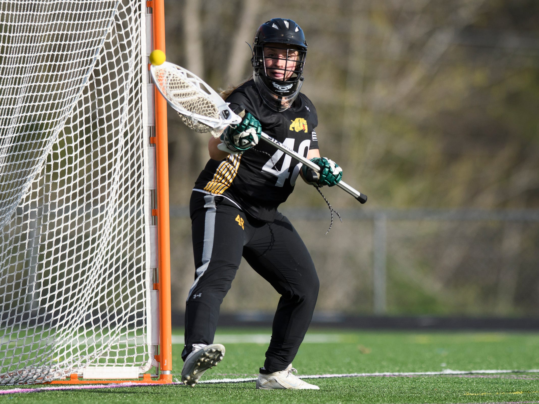 Burr and Burton goalie Cassie Pearce (48) makes a save during the high school girls lacrosse game between Burr and Burton Bulldogs and the South Burlington Wolves at Munson Field on Monday afternoon May 6, 2019 in South Burlington, Vermont.
