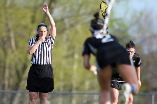Referee Dianne Gingue signals during the high school girls lacrosse game between Burr and Burton Bulldogs and the South Burlington Wolves at Munson Field on Monday afternoon May 6, 2019 in South Burlington, Vermont.