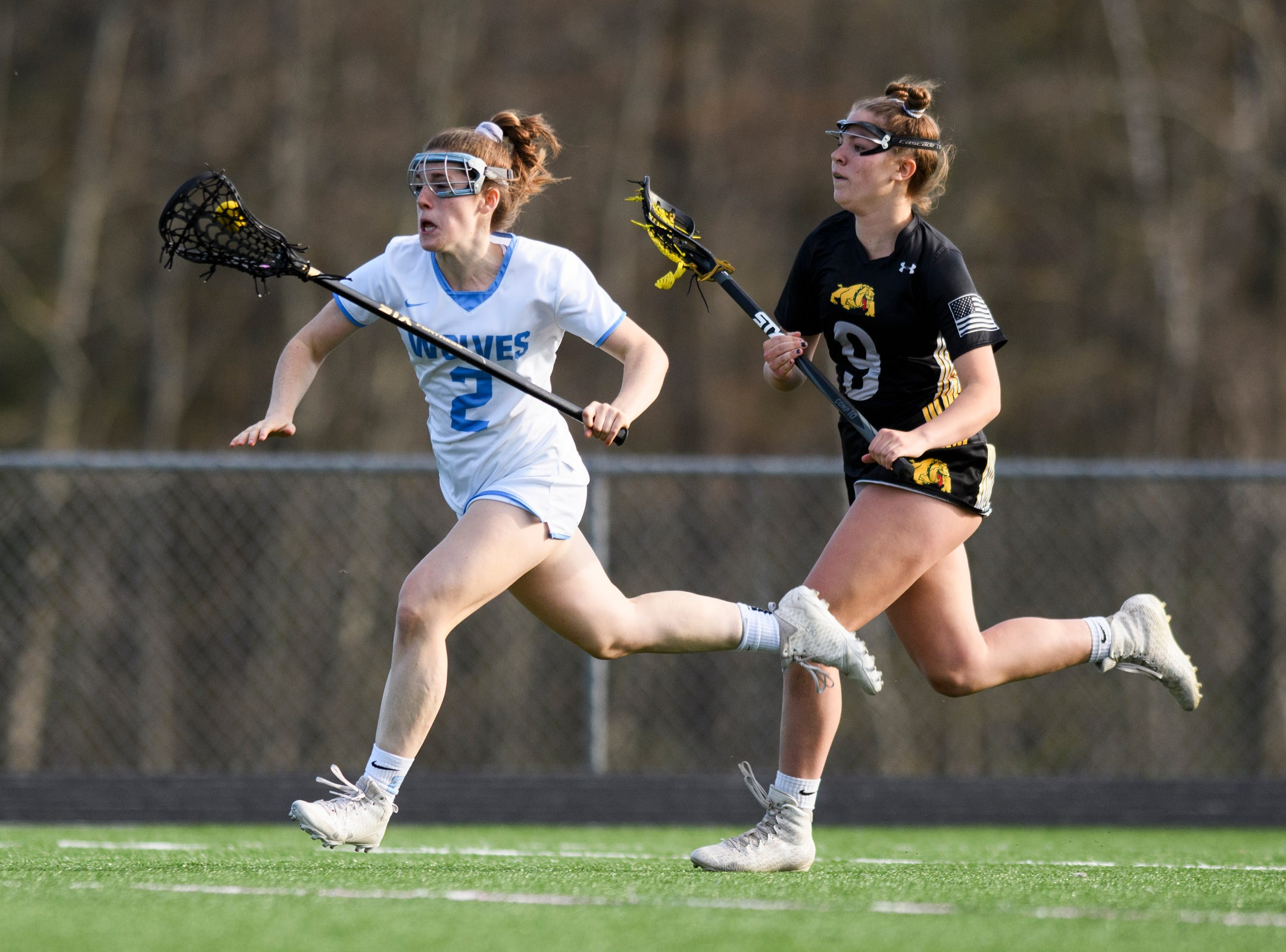 South Burlington's Kate Hall (2) runs down the field past Burr and Burton's Julia Fillion (9) during the high school girls lacrosse game between Burr and Burton Bulldogs and the South Burlington Wolves at Munson Field on Monday afternoon May 6, 2019 in South Burlington, Vermont..