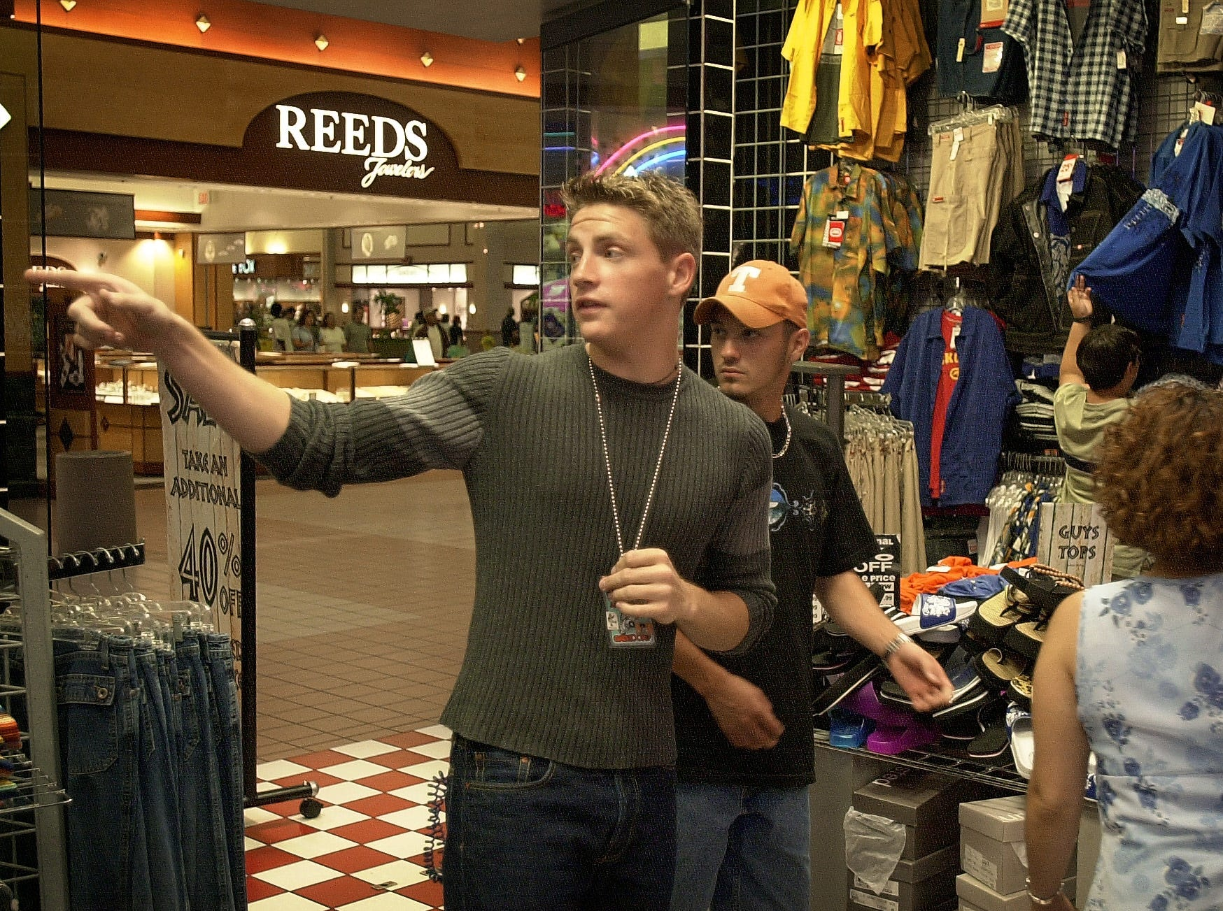 """Reid Lee (19) helps customers at """"Gadzooks"""" in Padre Staples Mall in Corpus Christi in July 2000."""