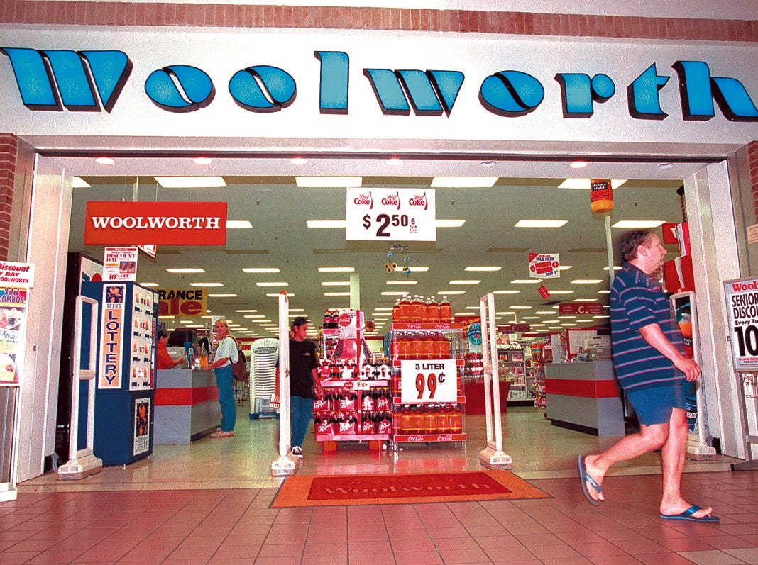 A patron leaves the Woolworth's in Padre Staples Mall in July 17, 1997. Store officials announced the Corpus Christi area stores would close.