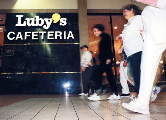 Walkers pass Luby's Cafeteria in Padre Staples Mall on Feb. 5, 1997.