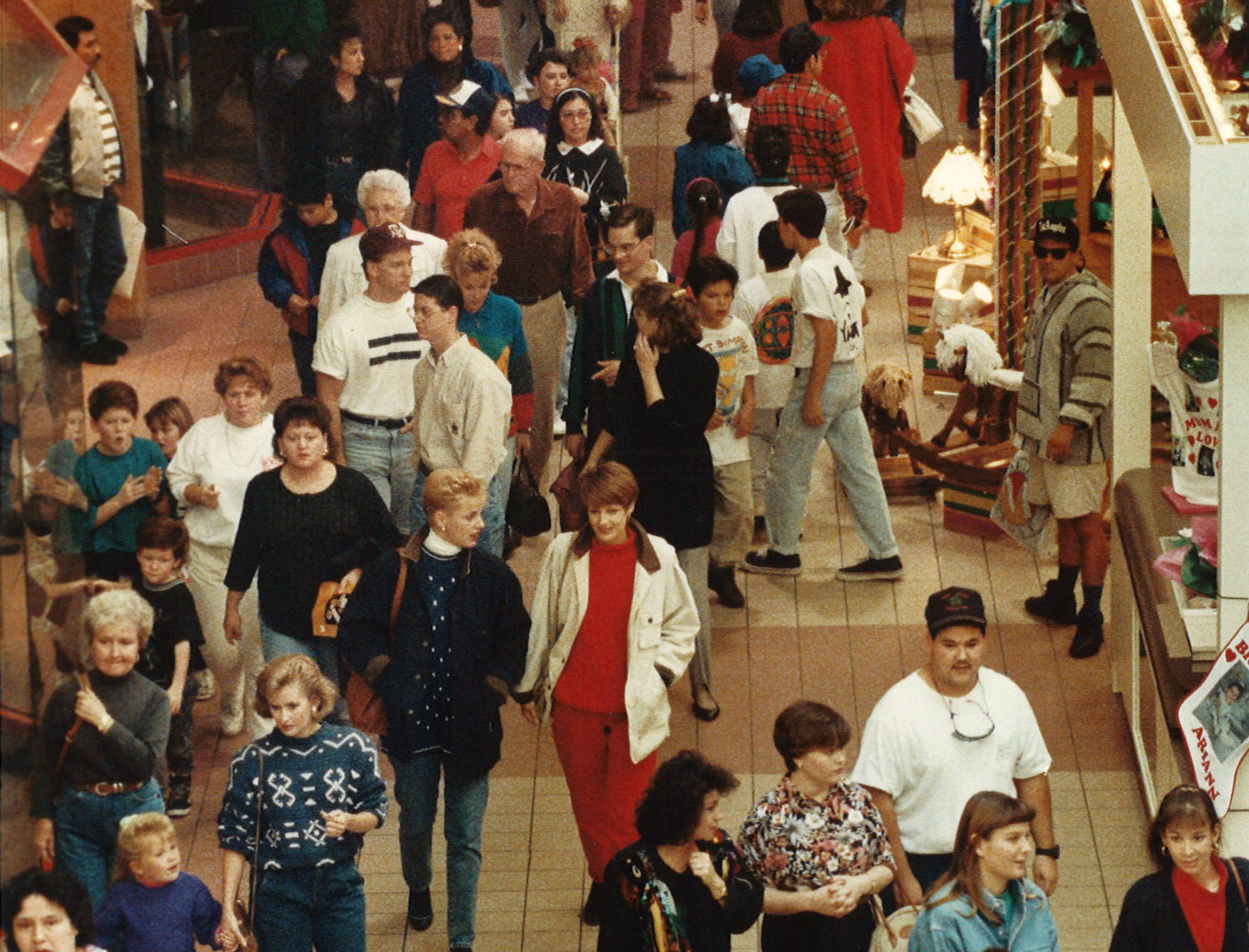 Christmas shoppers at Padre Staples Mall in Corpus Christi work their way through the crowds shortly after lunch time on Nov. 27, 1992.