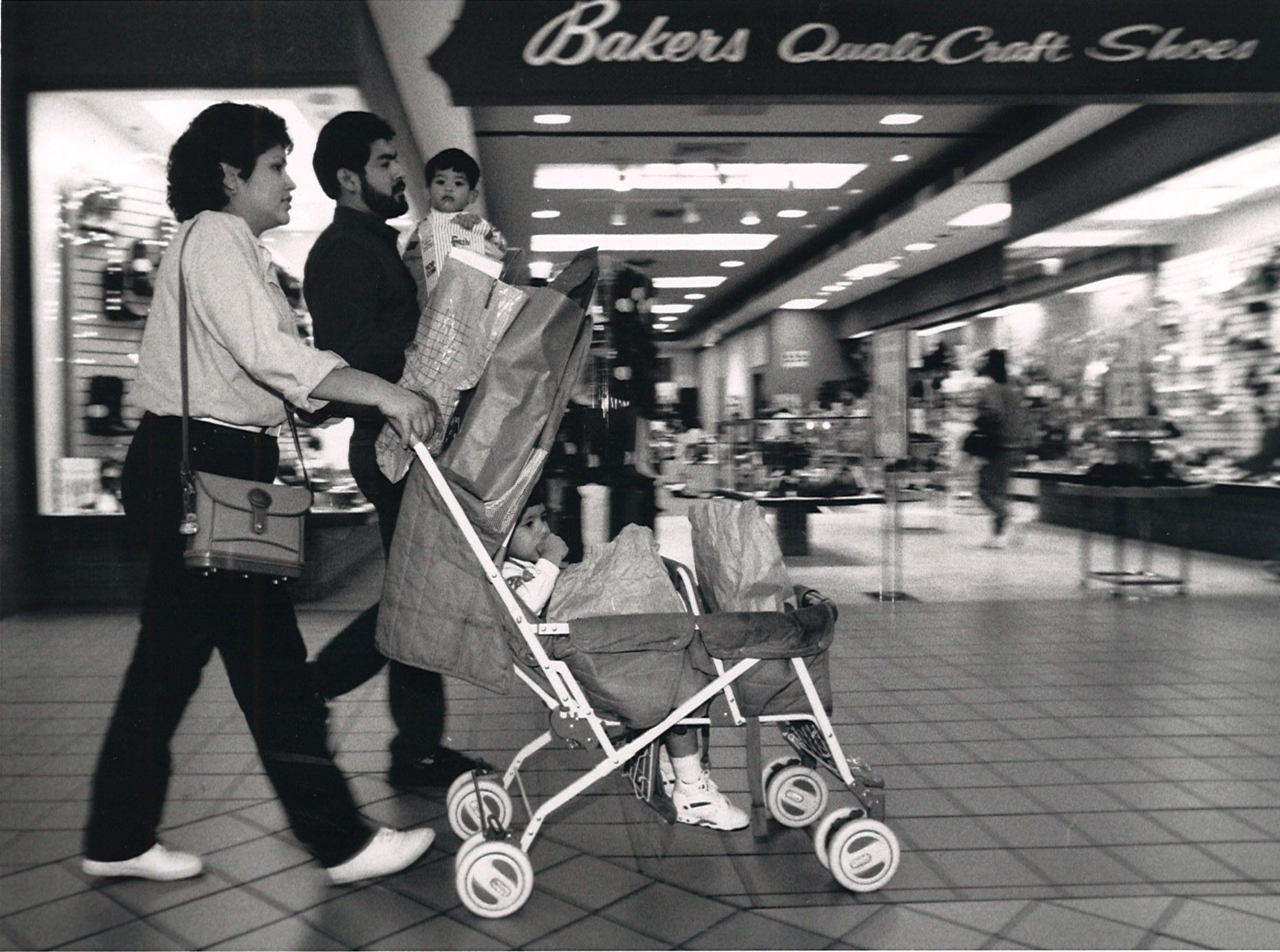 Becky and Albert Ysaguirre shop at Corpus Christi's Padre Staples Mall on Dec. 11, 1992. Sons Aaron (with Albert) and Alex (in stroller) accompanied their parents.