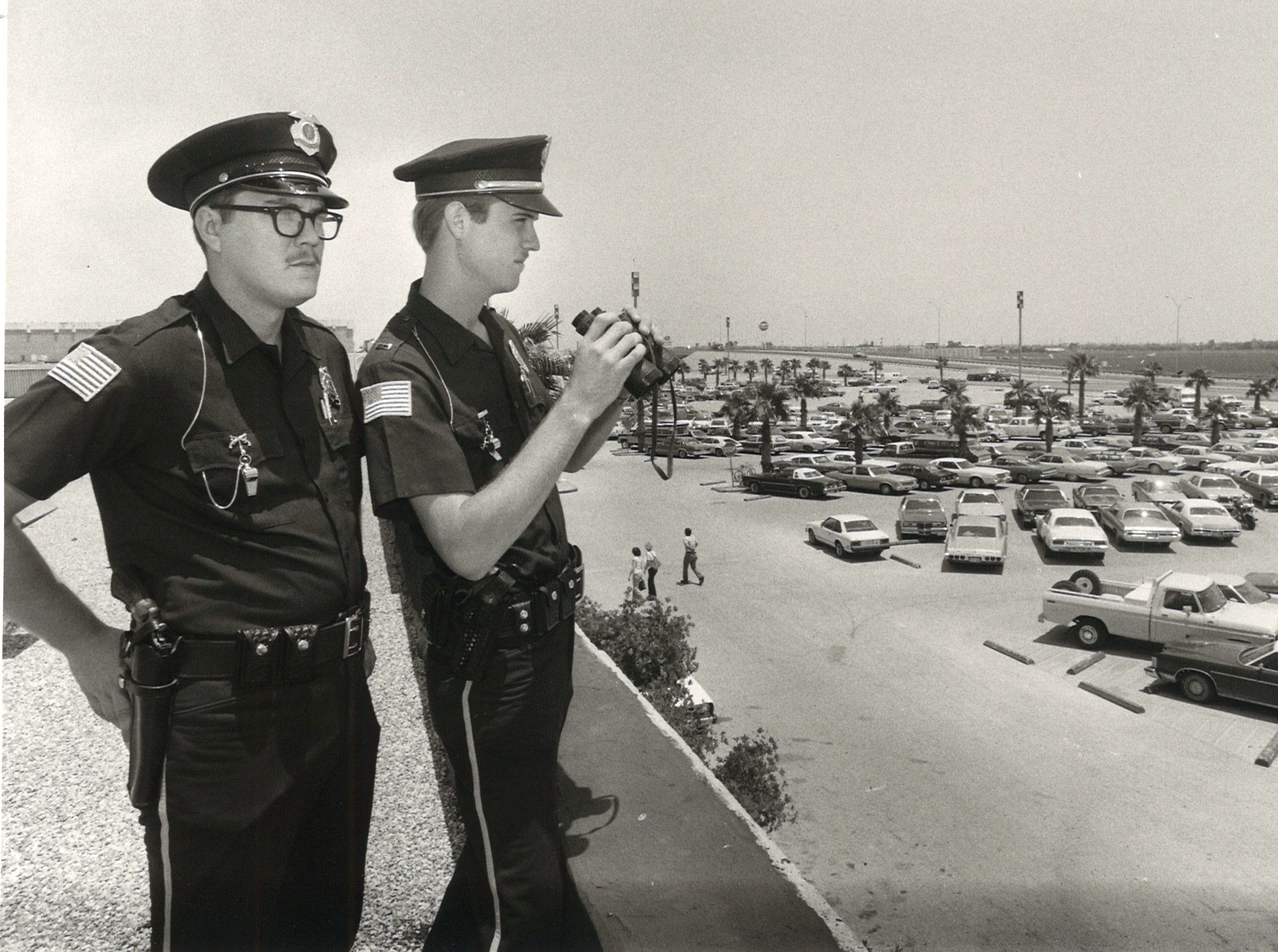 Padre Staples Mall security officers James Looney (left) andd Al Keeney keep an eye on the parking lot in June 1979.