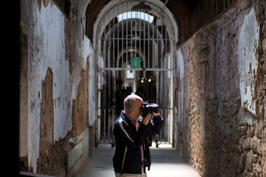 A tourist takes photos inside Eastern State Penitentiary in Philadelphia, Pa. Thursday, May 2, 2019.