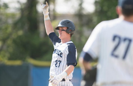 Shawnee's Nate Liedtka celebrates after hitting a RBI double during the 4th inning of the opening round Diamond Classic baseball game between Shawnee and Highland, played at Shawnee High School in Medford on Tuesday, May 7, 2019.  Shawnee defeated Highland, 3-2.
