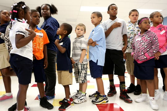 Students at the diverse Roberts Paideia Academy in East Price Hill line up in a file photo from 2014. Two of three students at the school are Hispanic; a little more than a decade ago, the number of Hispanic students could be counted on one hand.
