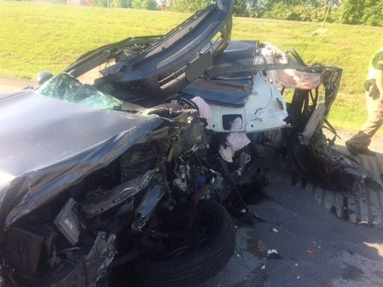 A car hit a stopped semi-tractor trailer Tuesday morning shutting down northbound Interstate 75 for several hours.