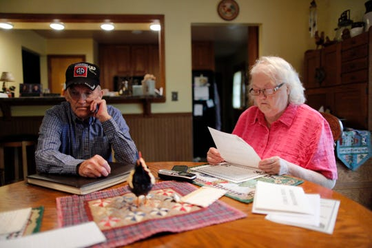 "Amuel ""Sonny"" Fleek and his wife Tracy recall stories about Sonny's brother, Charles ""Chalkie"" Fleek, as he flips through old photo albums and records at his home in Dillsboro, Ind., on Thursday, May 2, 2019. Chalkie Fleek was killed in action during the Vietnam War and was later awarded the Medal of Honor for his valor in combat."