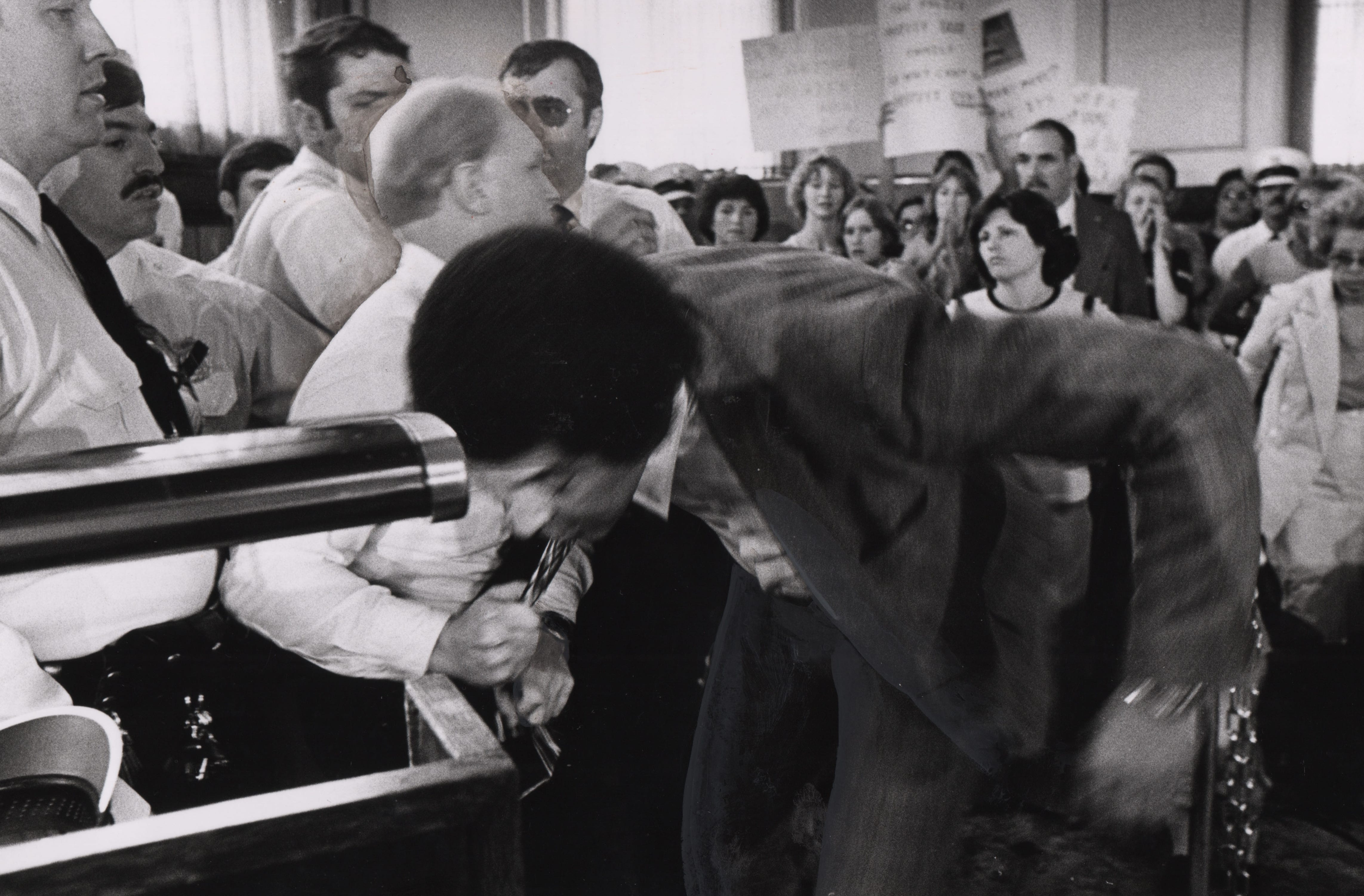 J. C. Johnson, president of the Cincinnati Chapter of the NAACP was jerked down by the necktie before a City Council meeting on May 10, 1979.