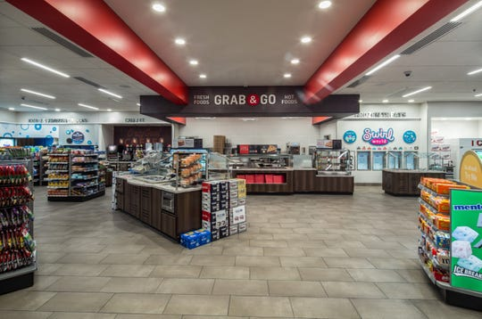 """Race Trac features """"on-the-go food and beverage favorites,including fresh pizza and roller grill items,complete with a toppings bar,"""" corporate spokeswoman Megan Shannon said."""