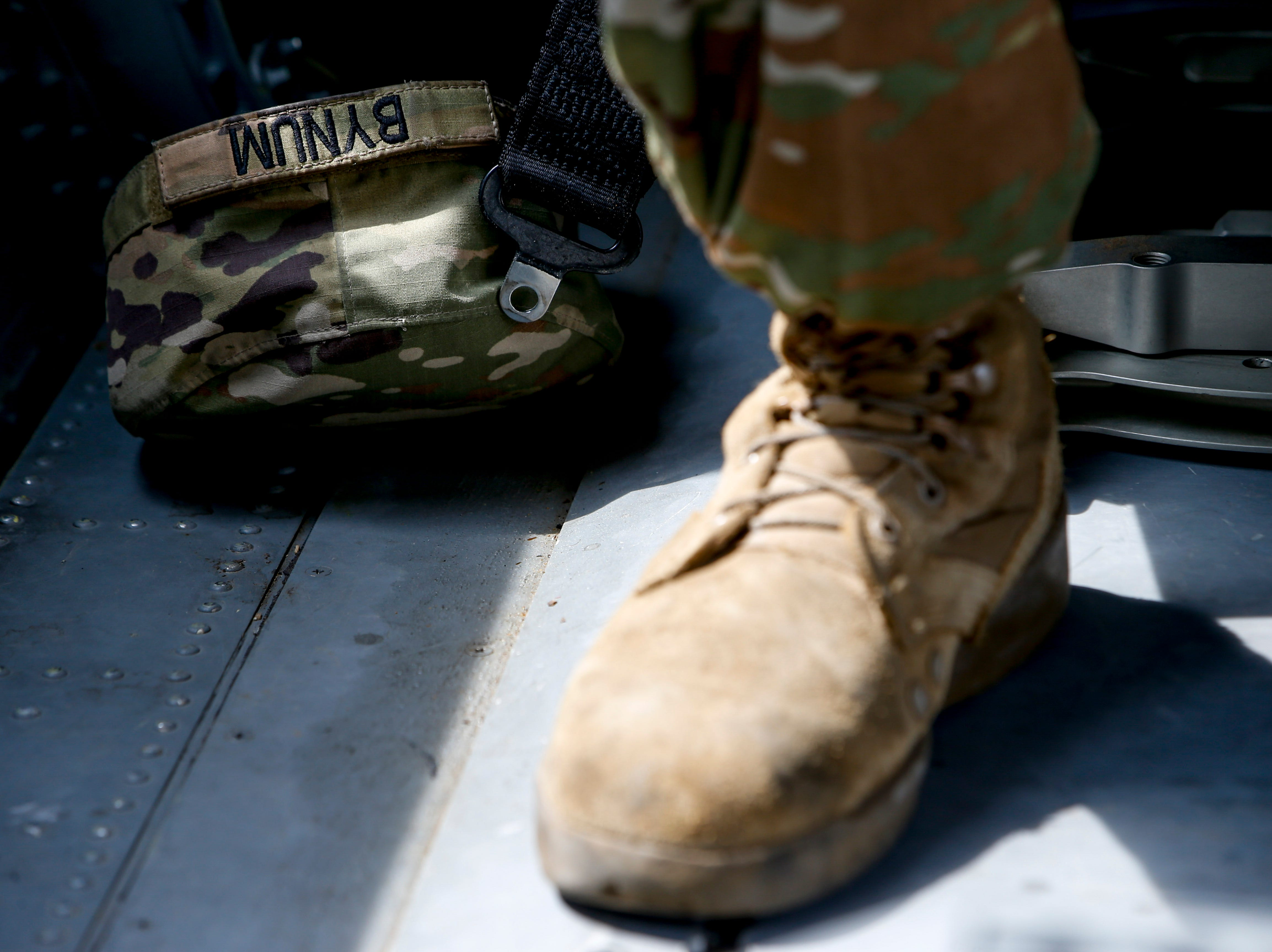 Sgt. Emmanuel Bynum places his hat on the floor of a helicopter as he shares the story of the mission he and Sgt. Armando Yanez were awarded the Silver Star at Campbell Army Airfield in Fort Campbell, KY., on Wednesday, May 1, 2019.