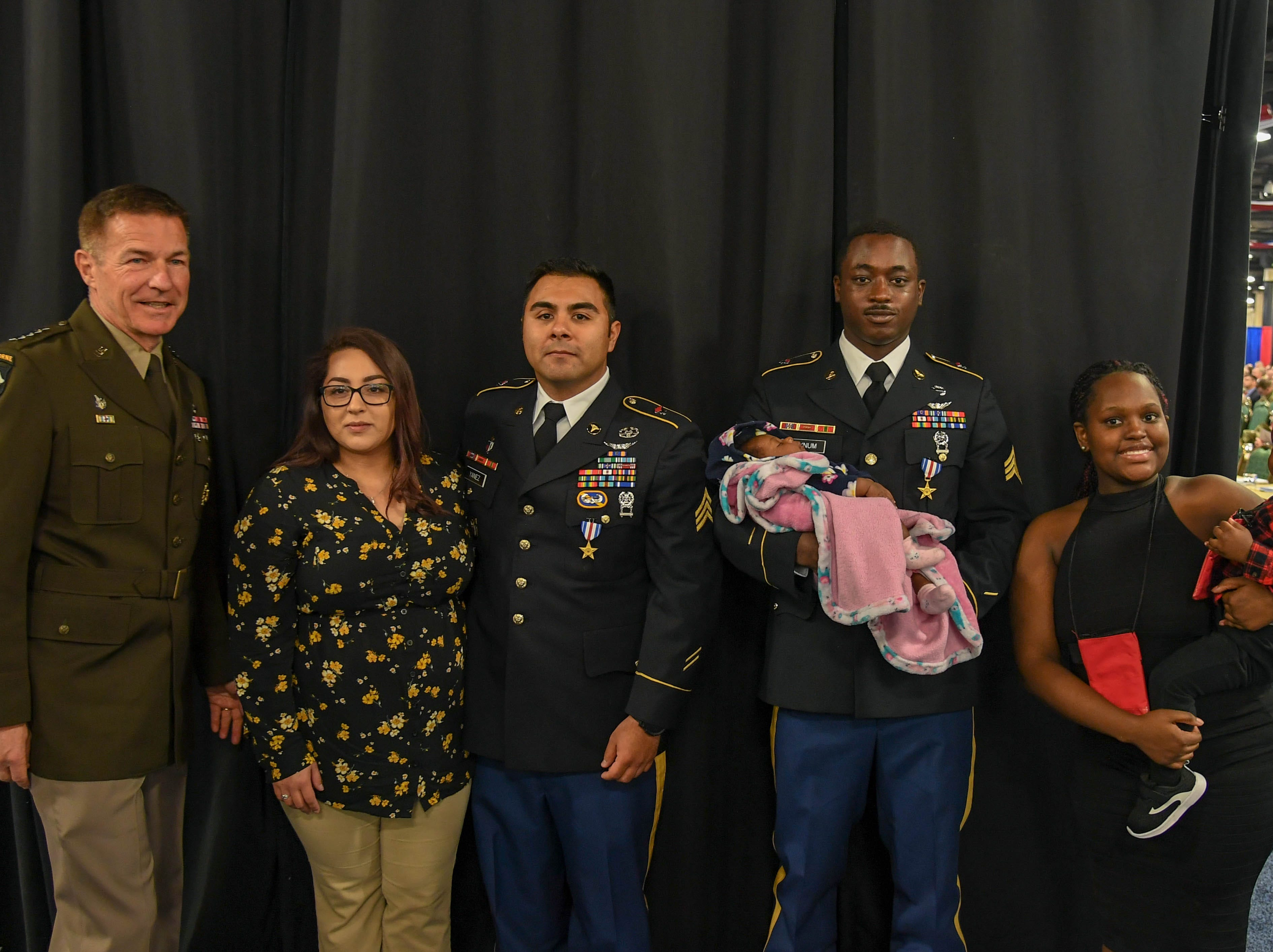 Sgt. Emmanuel Bynum and Sgt. Armando Yanez, 101st Combat Aviation Brigade, stand with family members and General James McConville after receiving the Silver Star on April 16, 2019, for heroism in combat during a medevac mission last year in Afghanistan.