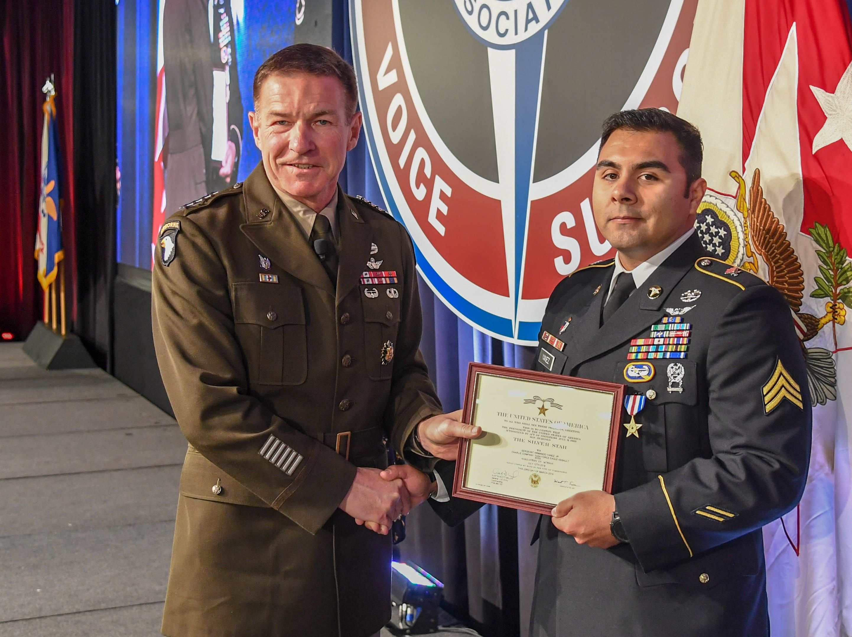 Sgt. Armando Yanez, 101st Combat Aviation Brigade, poses for a photo with General James McConville after receiving the Silver Star on April 16, 2019, for heroism in combat during a medevac mission last year in Afghanistan.