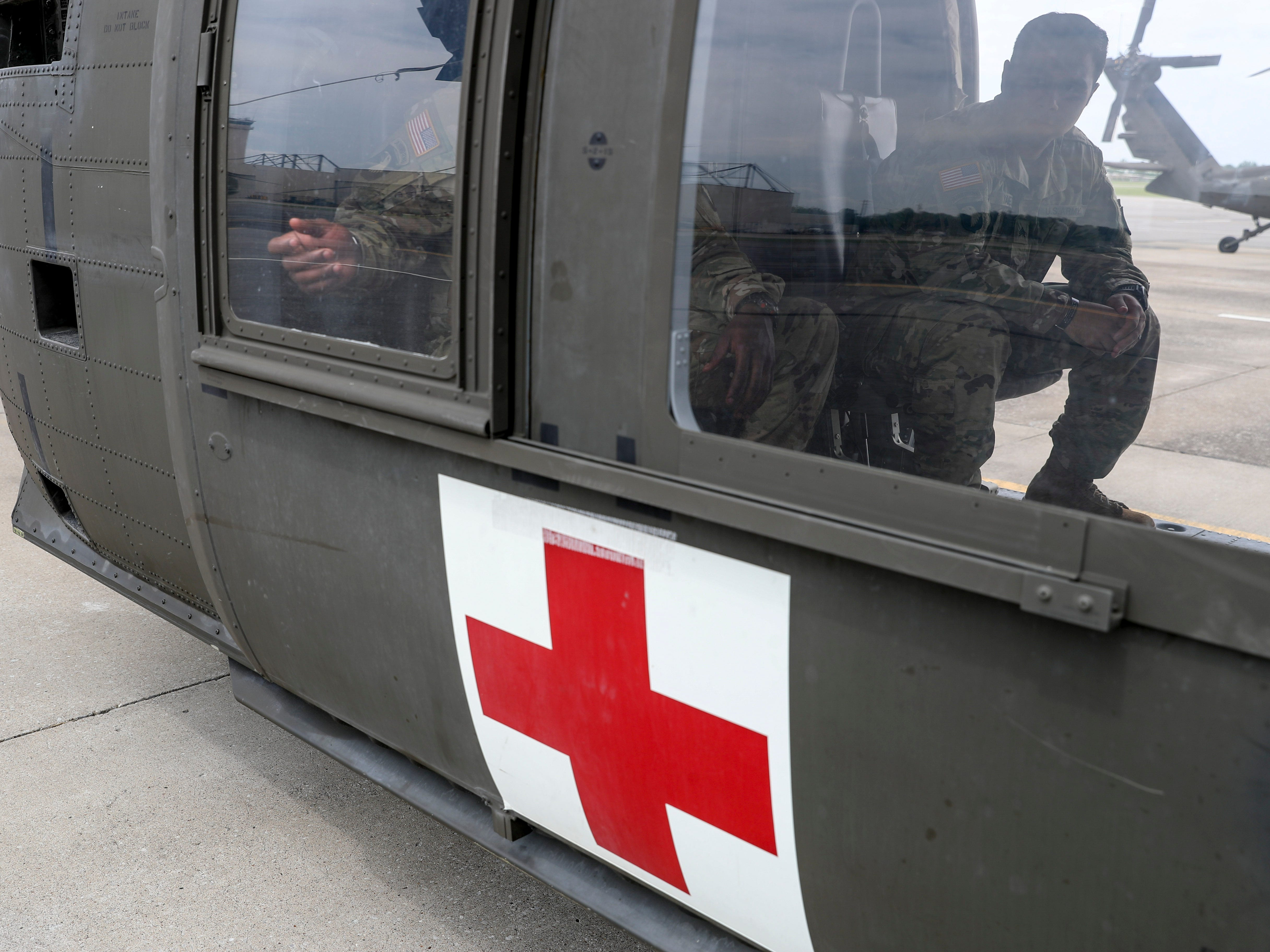 Sgt. Emmanuel Bynum taps on the window of a Black Hawk helicopter while sharing he and Sgt. Armando Yanez' story at Campbell Army Airfield in Fort Campbell, KY., on Wednesday, May 1, 2019.