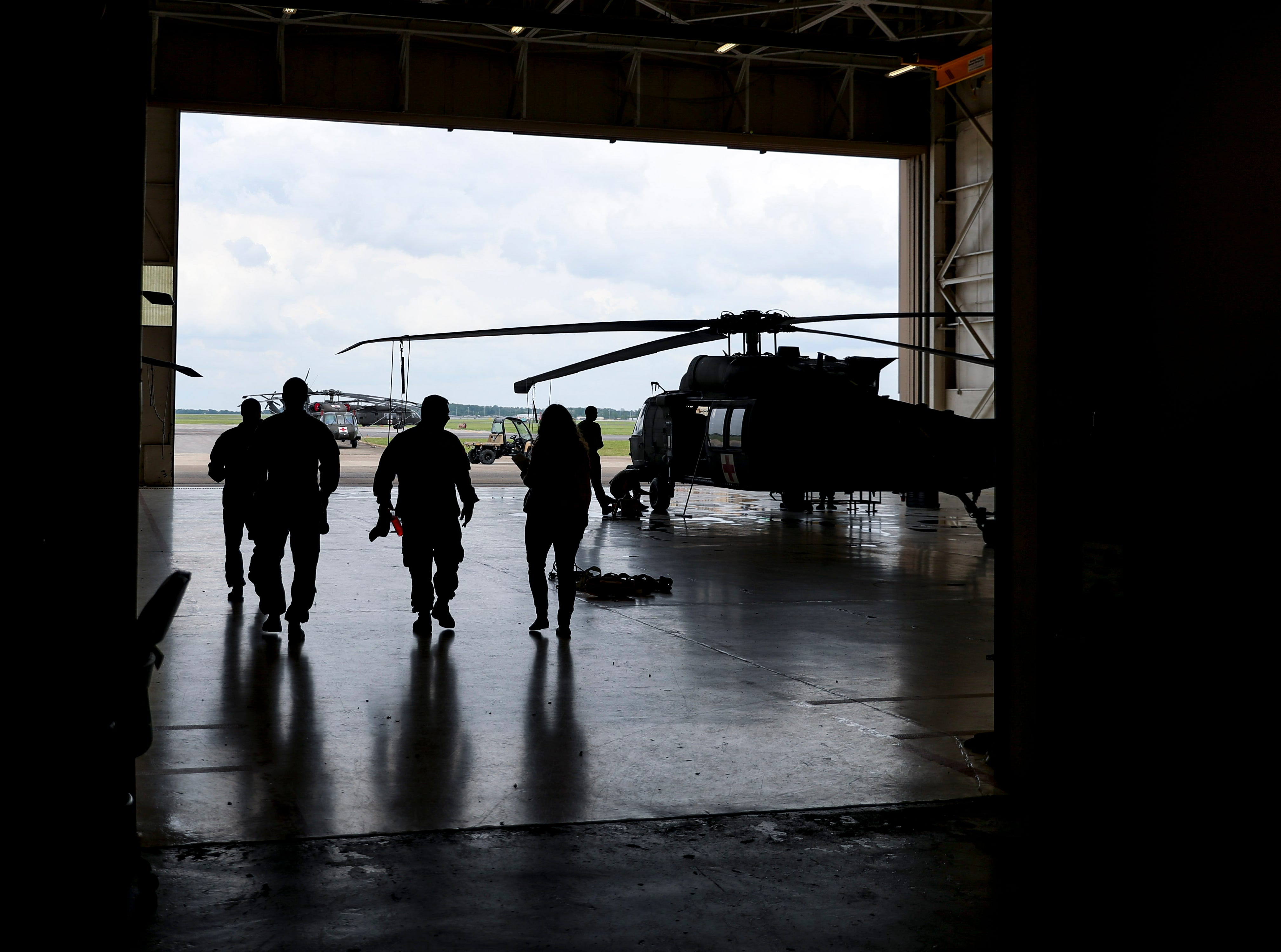 Soldiers walk towards the doors of Hangar 3 at Campbell Army Airfield in Fort Campbell, KY., on Wednesday, May 1, 2019.