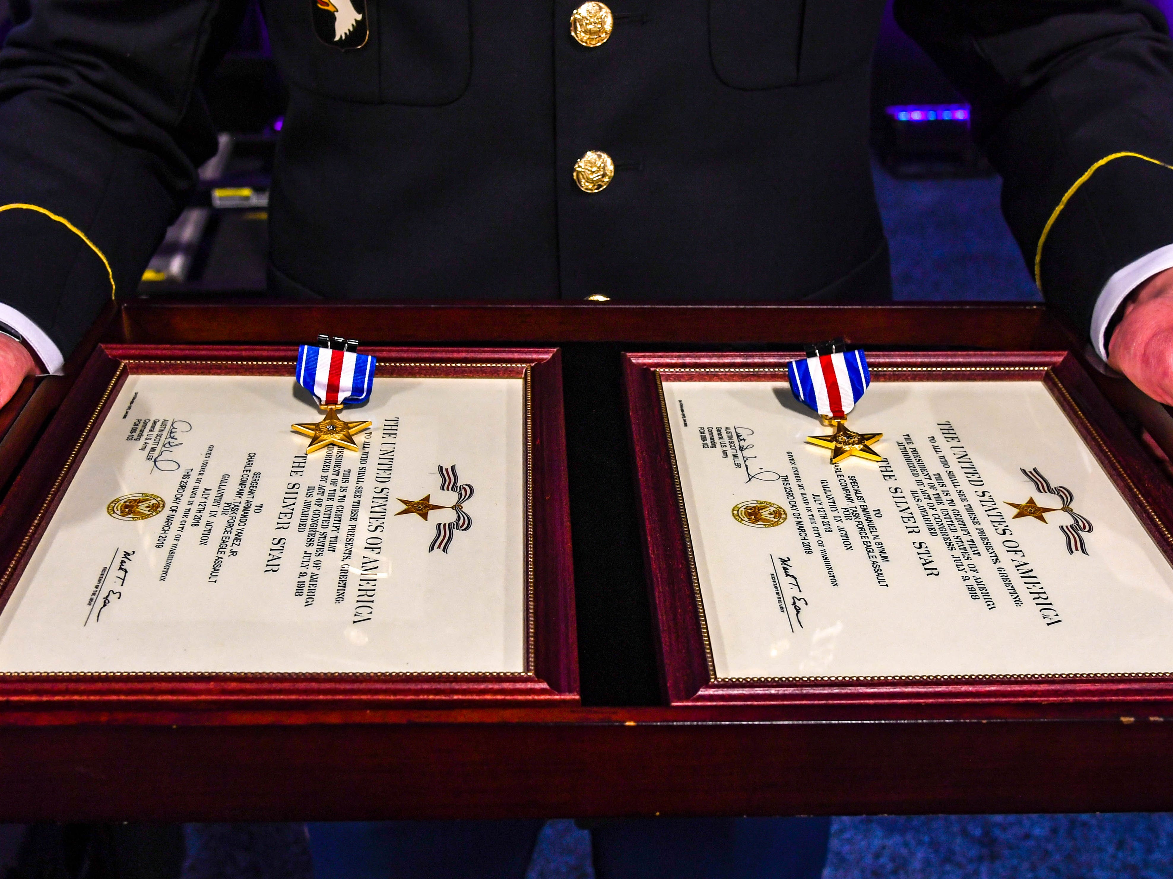 The citations for the Silver Stars awarded to Sgt. Armando Yanez and Sgt. Emmanuel Bynum of the 101st Airborne Combat Aviation Brigade on April 16 at the Army Aviation Association of America Summit 2019 in Nashville.