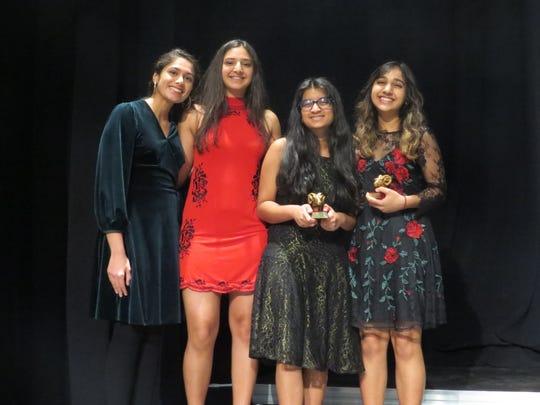 INDIE Film Festival committee members Aanandi Murlidharan (left) and Sanjna Patel, both of Edison, pose with Golden Ram winners Esha Nalla and Krishna Patel.