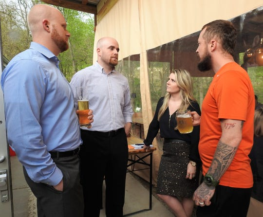 Chris Wallace, Kyle Libby, Stephanie Conrad and John Wayne talk over beers at the NextGen Coshocton's first Take Over event recently held at Wooly Pig Farm Brewery. The next event for the new, informal club will be May 22 at Hannah Marie's.
