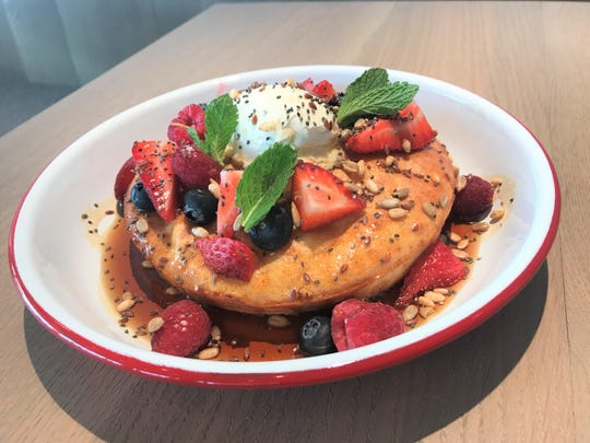 The ricotta hotcake from St. Kilda Surf & Turf, topped with local maple syrup, whipped mascarpone, fresh berries, chia and sunflower seeds, flax and puffed rice.