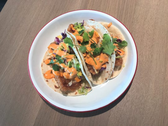 Fish tacos with battered and fried cod, cilantro slaw, pickled radish, harissa-lime aioli and flour tortillas from St. Kilda Surf & Turf.