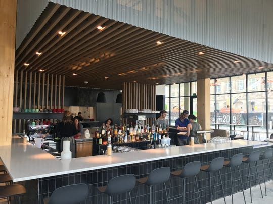 The bar at St. Kilda Surf & Turf is located in the center of the dining space.