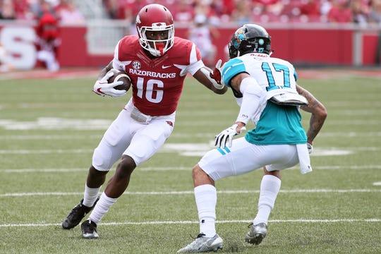 Arkansas wide receiver La'Michael Pettway (16) gains yardage after a catch against Coastal Carolina in 2017.