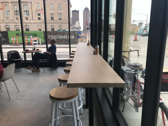 Diners can look out at Grand Ave. and the Des Moines skyline in the dining room of St. Kilda Surf & Turf.
