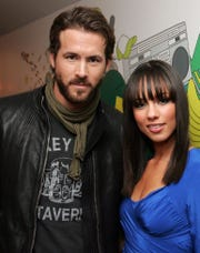 Actor Ryan Reynolds and singer Alicia Keys  pose backstage during MTV's Total Request Live at the MTV Times Square Studios January 23, 2006 in New York City.