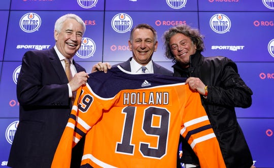 Bob Nicholson, CEO and Vice-Chair of the Edmonton Oilers NHL hockey team, left, and team owner Daryl Katz, right, flank new general manager Ken Holland, after announcing the hire in Edmonton, Alberta, Tuesday, May 7, 2019.