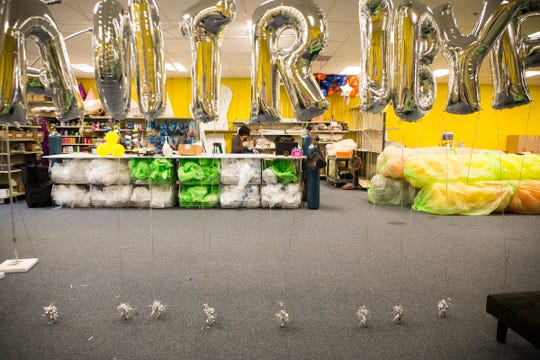 A birthday message is spelled out in helium balloons at Party Paradise, despite the current nationwide helium shortage as Nada Brikho, 56 of Shelby Twp. fills another order in Sterling Heights, Mich., Tuesday, May 7, 2019.