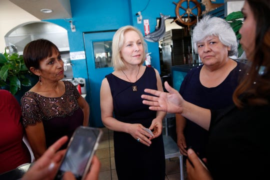 Democratic presidential candidate Sen. Kirsten Gillibrand, center, meets with community activists on immigration issues at a restaurant, Monday, May 6, 2019, in Las Vegas.