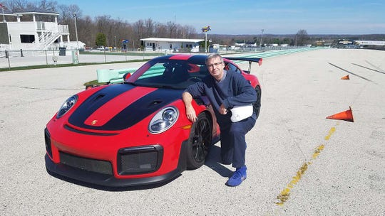 Detroit News auto columnist Henry Payne took the Porsche 911 GT2 RS for some quick laps around Wisconsin's Road America.