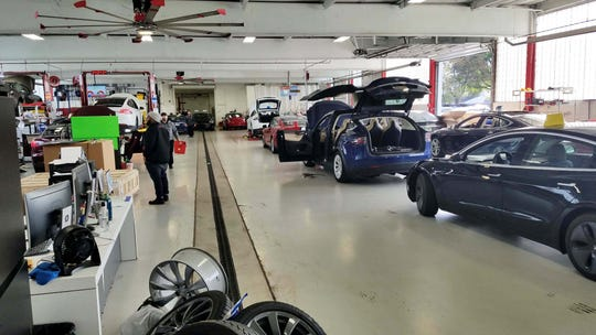 Michigan buyers pick up their cars from Tesla's Cleveland-Lyndhurst dearship. The service department features eight bays and plenty of work for employees on Tesla's three models: S, X, and the high- high-volume 3.