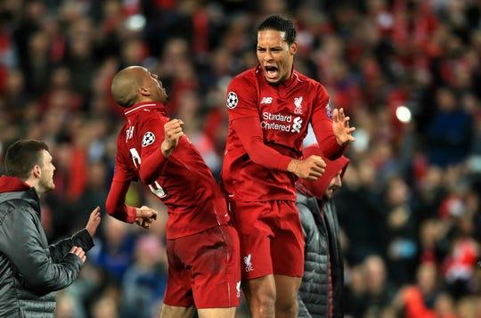 Liverpool's Fabinho, left, and Virgil van Dijk celebrate after the Champions League semifinal win over Barcelona.