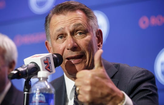 Newly named Edmonton Oilers general manager Ken Holland gestures while speaking at a press conference.