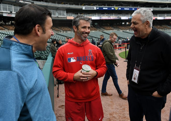 Former Tigers manager and current Angels manager Brad Ausmus talks with members of the media before Tuesday's game at Comerica Park.