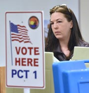 Aubrey Kalota of Walled Lake votes in a special election at the Walled Lake Fire Department Headquarters on Tuesday.