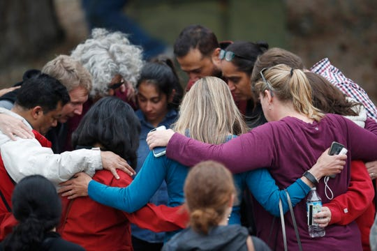 Parents gather in a circle to pray at a recreation center where students were reunited with their parents after a shooting at a suburban Denver middle school Tuesday, May 7, 2019, in Highlands Ranch, Colo.