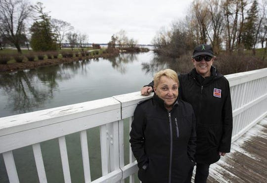 Christine Petersen and Beth Guntzviller on the Library Bridge in Elk Rapids. They said they frequently pick up cigarette butts from the beaches and parks.