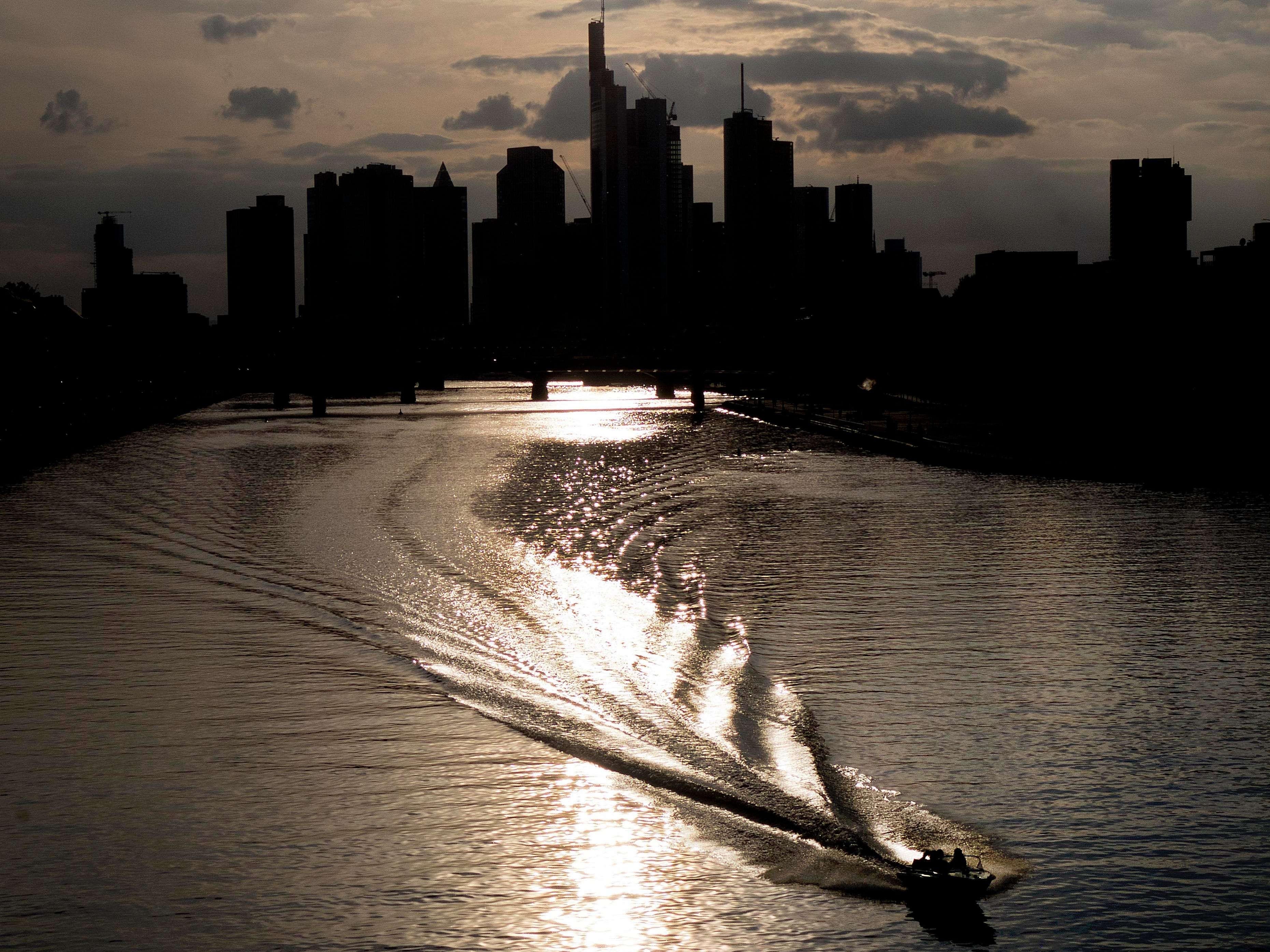 A motor boat cruises over the river Main during sunset in Frankfurt, Germany, Tuesday, May 7, 2019.