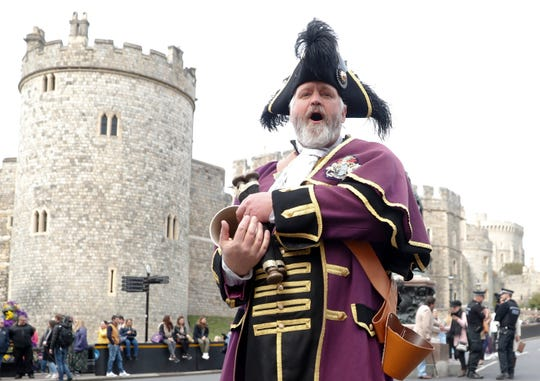 Royal Borough of Windsor and Maidenhead official Town Crier Chris Brown announces the news of the birth of a baby boy to Prince Harry and his wife Meghan, Duchess of Sussex, outside Windsor Castle in Windsor, south England, Monday May 6, 2019.