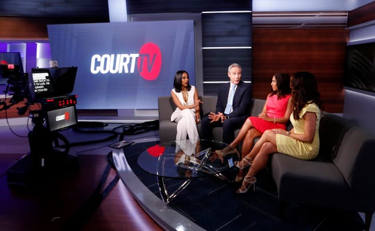 In this Thursday, May 2, 2019, photo, Court TV anchors from left, Yodit Tewolde, Vinnie Politan , Seema Iyer and Julie Grant discuss a court case as they rehearse on the set, in Atlanta.
