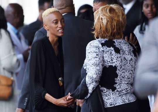 Justice Maya Singleton, left, daughter of the late film director John Singleton, greets guests at a memorial service for Singleton at Angelus Funeral Home, Monday, May 6, 2019, in Los Angeles.