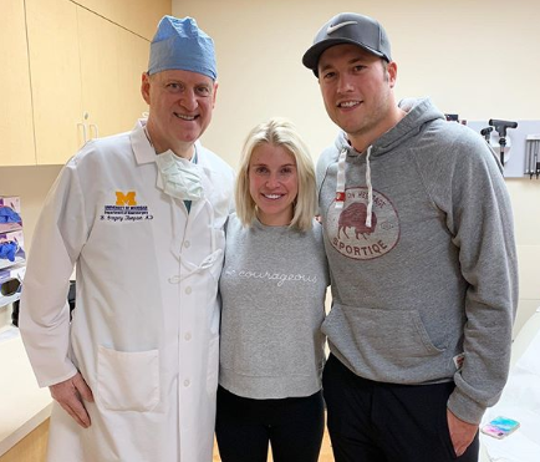 Kelly Stafford and Matthew Stafford with Dr. B. Gregory Thompson.