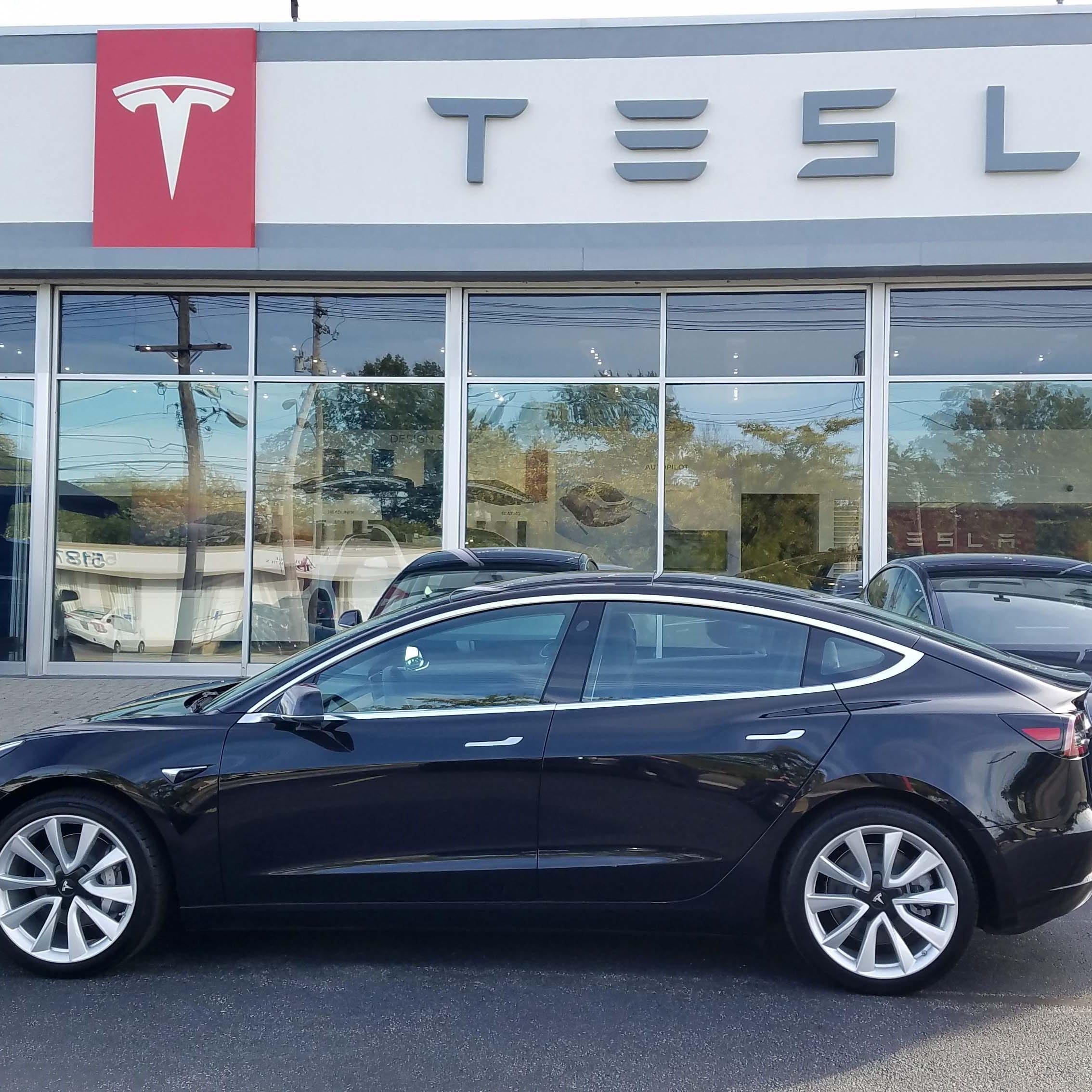 Payne: Tesla opens new Toledo center as it fights Michigan ban