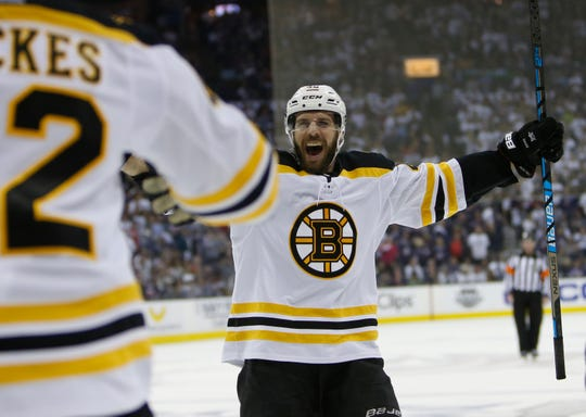 Boston Bruins' David Krejci, of the Czech Republic, celebrates a goal against the Columbus Blue Jackets during the third period of Game 6 Monday. Boston won 3-0 to win the series 4-2.